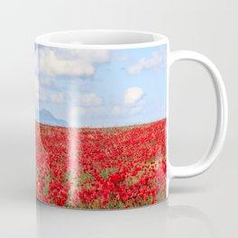 World War II Supermarine spitfire fighter plane flying over poppy field Coffee Mug