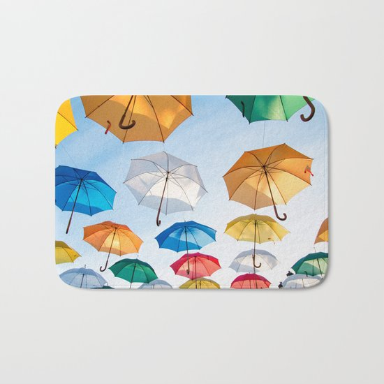 umbrellas flying Bath Mat