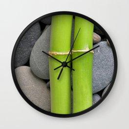 Green Bamboo Sticks on Pebble Wall Clock