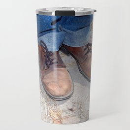 Boots on the ground of the foot Travel Mug