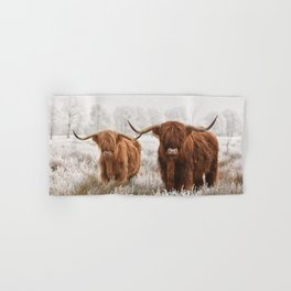 Hairy Scottish highlanders in a natural winter landscape. Hand & Bath Towel