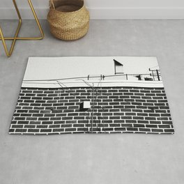 brick wall building with hood and electronic wires in black and white Rug