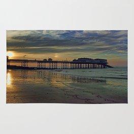 Cromer Pier at sunset Rug