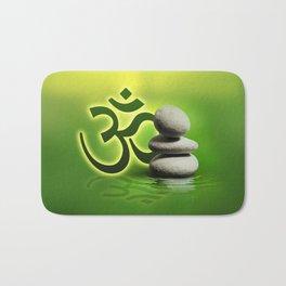 OM symbol  with zen stones on gentle green Bath Mat