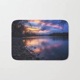 The Edge of Night sunset on the Sacramento River Bath Mat