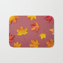 Autumn fallen leaves on claret background Bath Mat