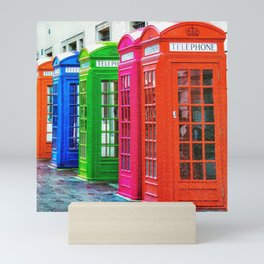 A Row of Brightly Colored Telephone Boxes Mini Art Print