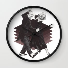 She can do everything he can, backwards and in heels Wall Clock