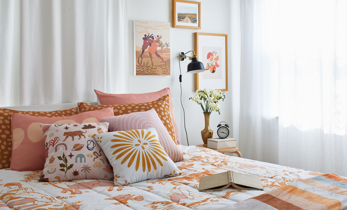 bed with pink, yellow and orange bedding