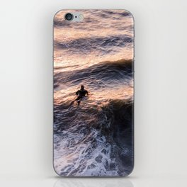 Lone surfer at sunset waiting for the next wave iPhone Skin