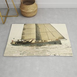 old sailboat in sailrace Rug