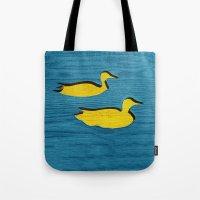 ducks Tote Bags featuring Ducks by Brontosaurus