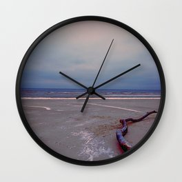 Logging by the sea Wall Clock