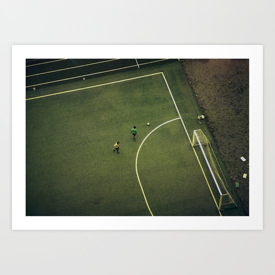 Kids are playing football on the green field Art Print