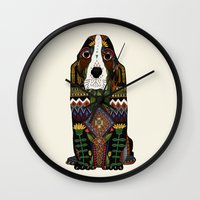 the hound Wall Clocks featuring Basset Hound by Sharon Turner
