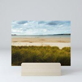 Beach against cloudy sky in Brittany Mini Art Print