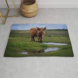 Highland Cow By The Water Puddle Rug