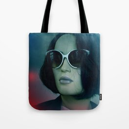 emerging from the shadow -2- Tote Bag