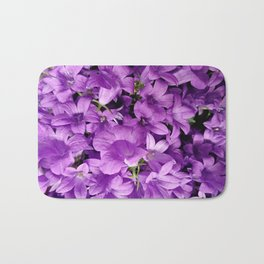 Campanula flowers as a background Bath Mat