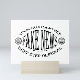 Fake News badge (black on white) Mini Art Print