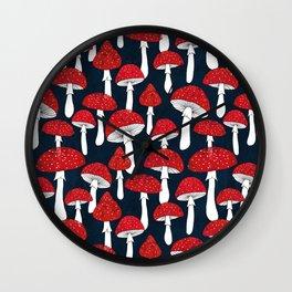 Red mushrooms field on navy blue Wall Clock