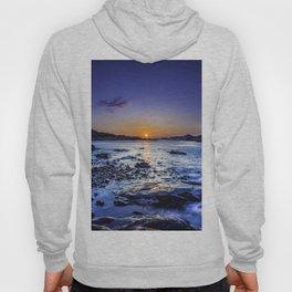 sunrise over horizon at seashore at dawn Hoody