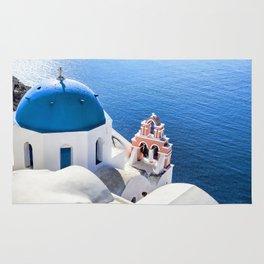 Blue and white church in Oia village, Santorini, Greece Rug
