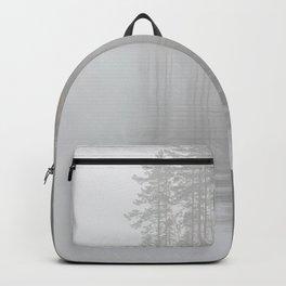 Trees reflection at lake foggy morning Backpack