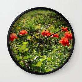 Red poppy flowers on green carpet Wall Clock