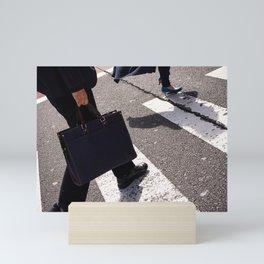 Group of businessmen and women walk along crosswalk in Shinjuku, Tokyo, Japan Mini Art Print