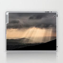 Sunbeams illuminate the hills below Laptop & iPad Skin