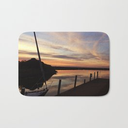 The dock at sunset Bath Mat
