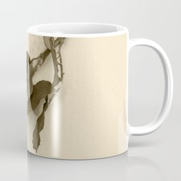 A lone rose resting in the snow Coffee Mug