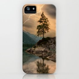 A scenic lake with Mountains & Lightning in the Distance. iPhone Case