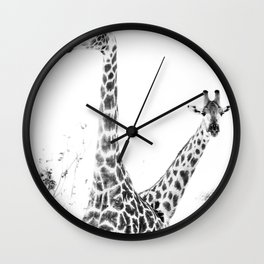between giraffes Wall Clock