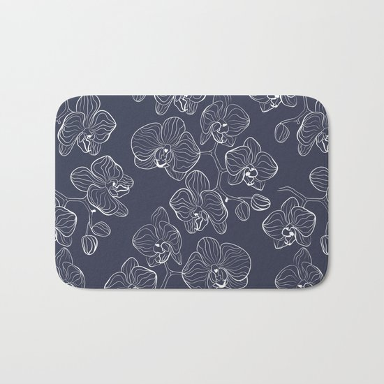 Retro . Orchid flowers on a blue background . Bath Mat