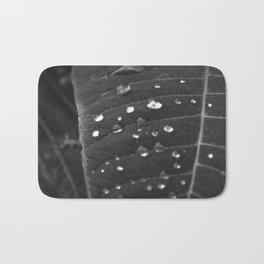 Shining Rain drops on a poinsettia leaf Bath Mat