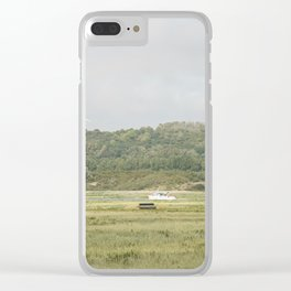 Boat on the grass Clear iPhone Case