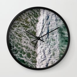 Riding high amongst the waves Wall Clock