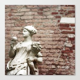 Old Brick Wall and Statue of a Woman Canvas Print