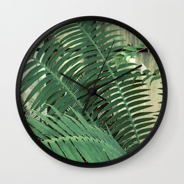 Fern Leaves By Window With Curtains Closed Tightly Wall Clock