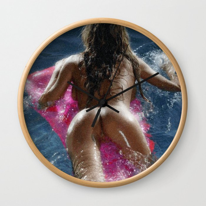 Girl on a pad in the swimming pool Wall Clock