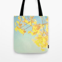 golden Tote Bags featuring golden by Life Through the Lens