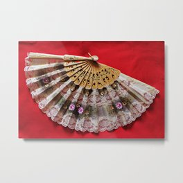 Ornate Hand Held Fan on a Red Background Metal Print
