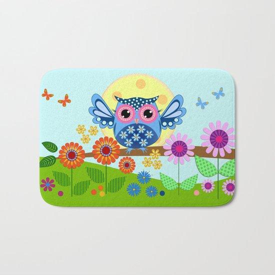 Spring owl in a Flower garden Bath Mat