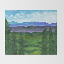 View from a mountain slope to distant mountains and forests Throw Blanket