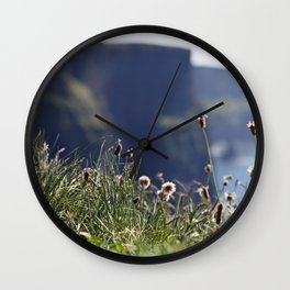 Wild flowers with the Cliffs of Moher in the back Wall Clock