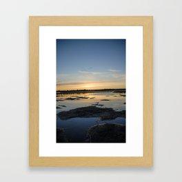 sunset on a lake Framed Art Print