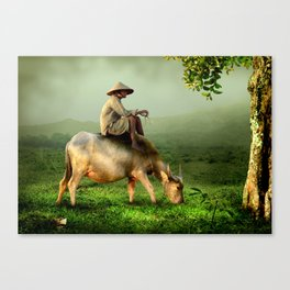 Water Buffalo Grazing with Farmer in a Scenic Pasture Canvas Print
