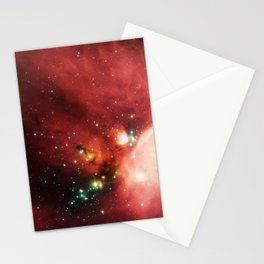 Newborn stars peek out from beneath their natal blanket of dust in this dynamic image of the Rho Oph Stationery Cards